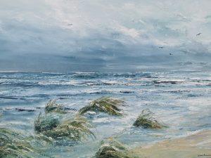 Översvämmad strand efter storm